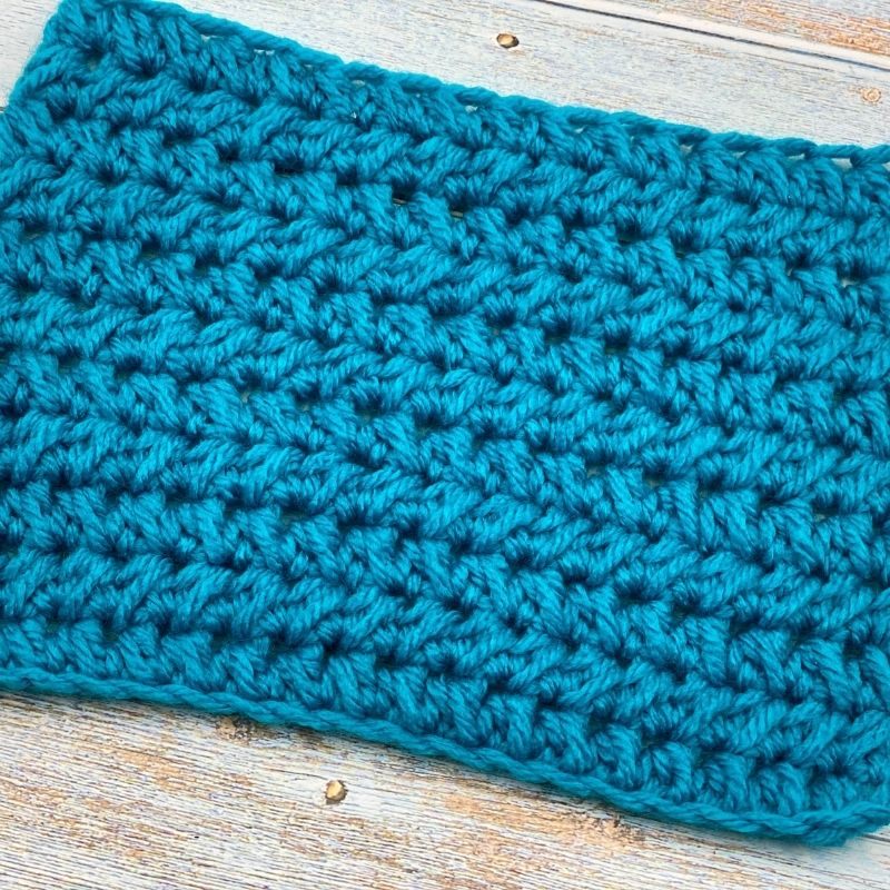 Learn to crochet the Half Double Crochet Cluster Cluster Stitch; photo and video tutorial